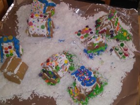 First year ever decorating Gingerbread houses: the mini village. Not sure if we will ever do this again....